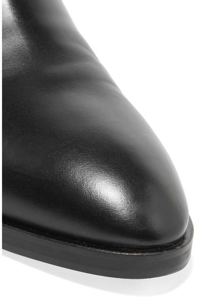 Alaïa Ankle Boots aus Leder mit Cut-outs und Applikationen