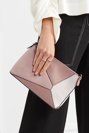 Puzzle mini textured-leather and suede shoulder bag