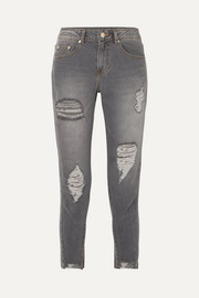 Cropped distressed mid-rise skinny jeans