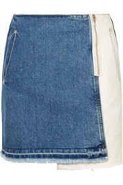 Distressed patchwork denim mini skirt