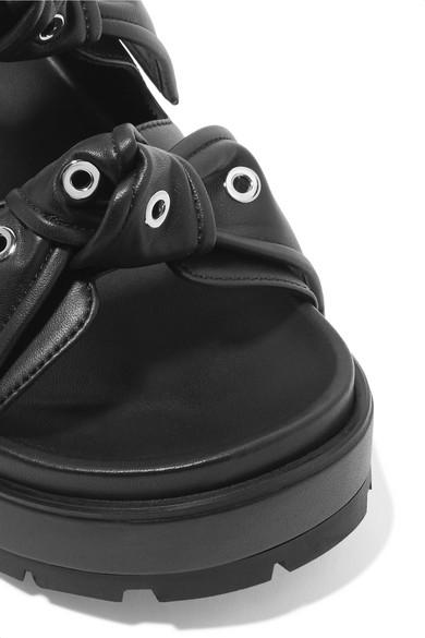 Alexander McQueen Ösenverzierte Lederpantoletten mit Plateau und Knotendetails