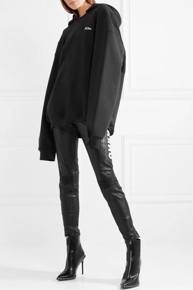 Unravel Project Eng geschnittene Hose aus Leder mit Applikationen