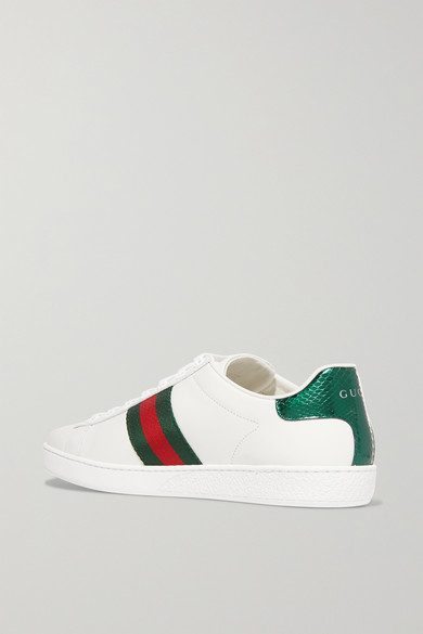 667bb35c836 Gucci. Ace watersnake-trimmed embroidered leather sneakers. £445. Zoom In