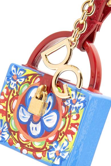Dolce & Gabbana Schlüsselanhänger aus Leder und bedrucktem Harz mit vergoldeten Details