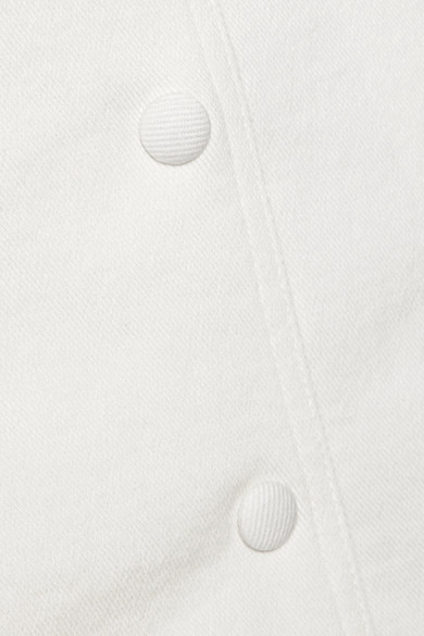 Nanushka Sedu Minirock aus Stretch-Denim mit Fransen und Gürtel