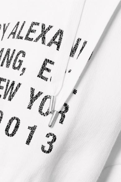 T by Alexander Wang Kapuzenoberteil aus bedrucktem Baumwoll-Jersey mit Fleece-Einsätzen