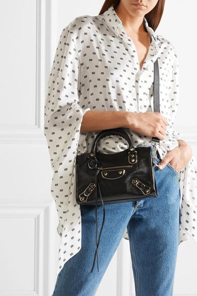 fdc85fe56edac Balenciaga. Classic Metallic Edge City mini textured-leather shoulder bag.  £1