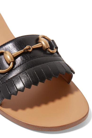 c9cfac7a96e Gucci. Varadero horsebit-detailed fringed leather slides.  600. Zoom In