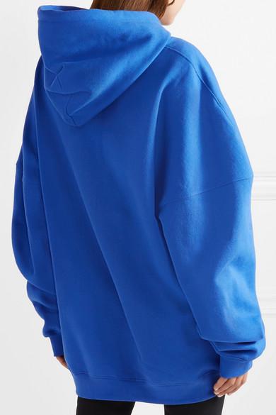 we11done Oversized-Oberteil aus Jersey aus einer Baumwollmischung mit Kapuze und Applikation