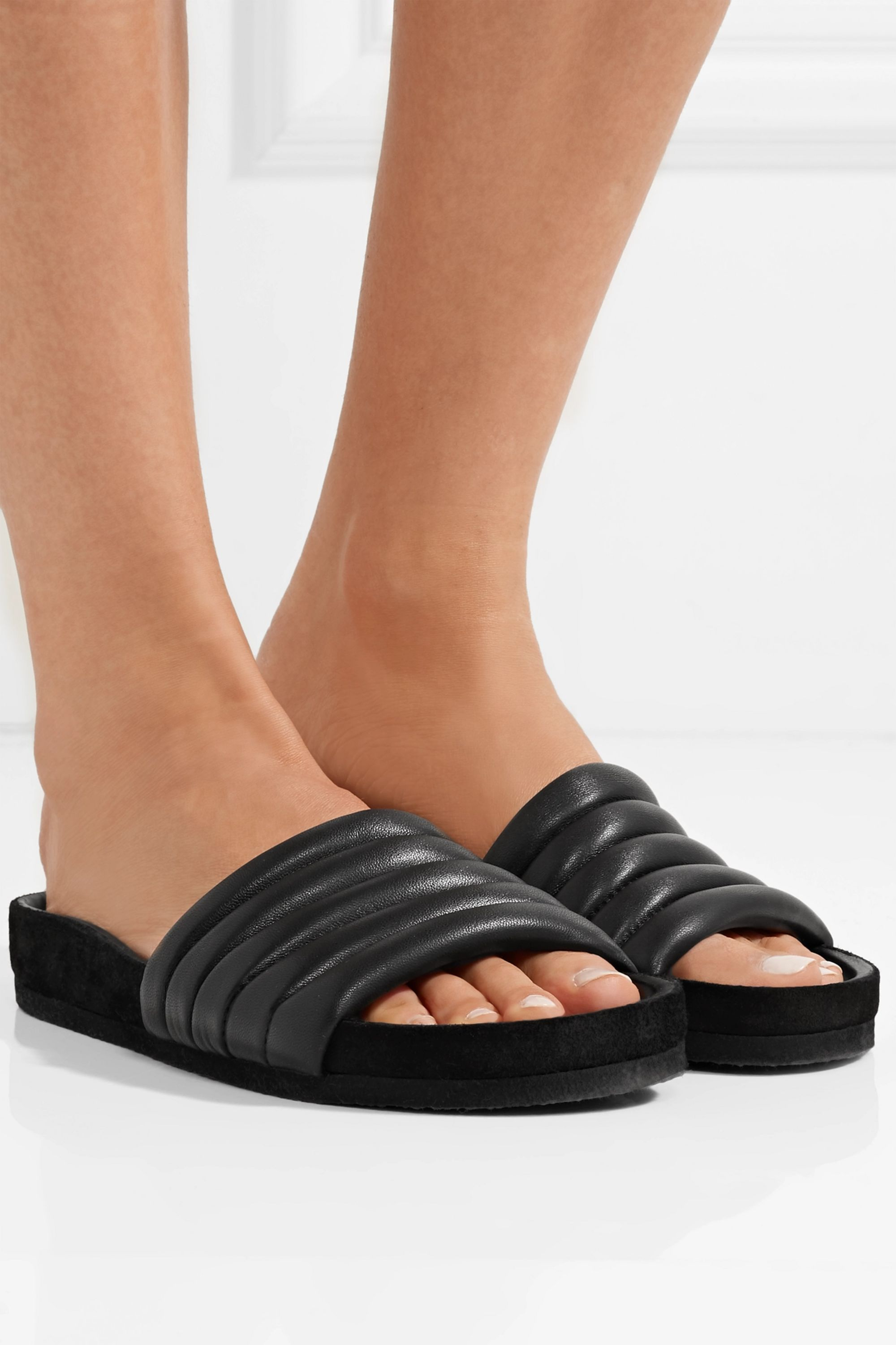 Black Hellea quilted leather slides