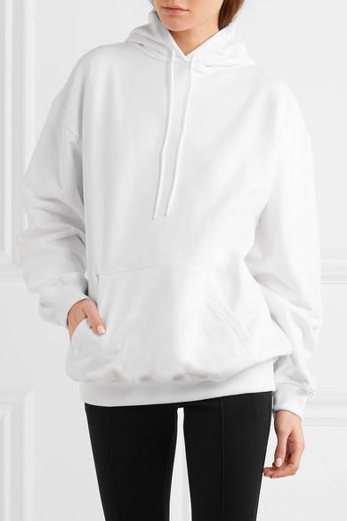 Balenciaga Oversized-Kapuzenoberteil aus Baumwollfrottee mit Print