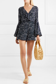 Flores wrap-effect ruffled printed crepe playsuit