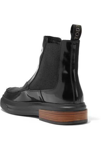 9229ae9abaeec Tod's. Glossed-leather Chelsea boots. $310.00. Reduced further. Play