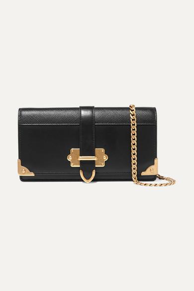 9e5c4aca64be Prada. Cahier smooth and textured-leather shoulder bag