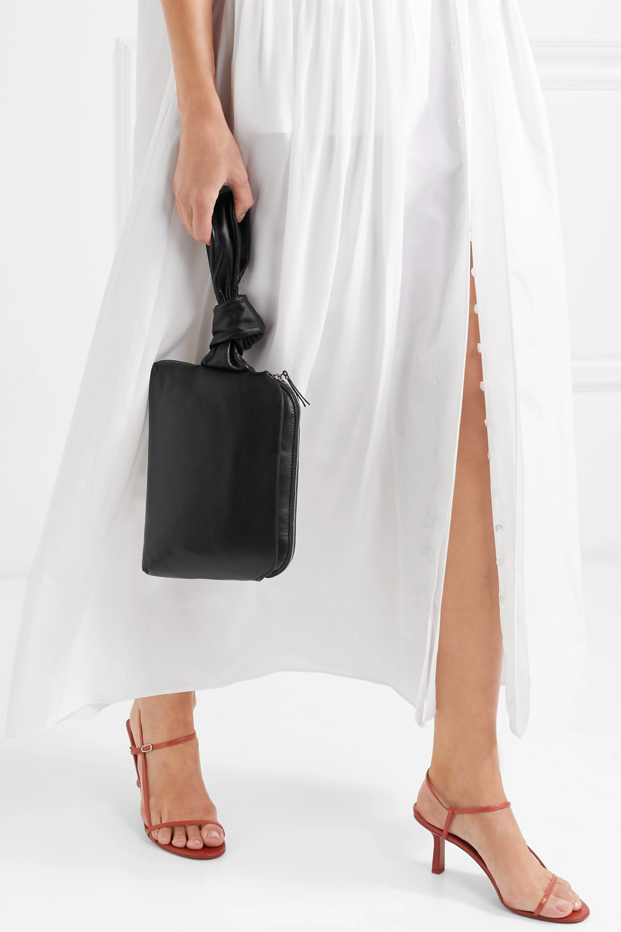 The Row Wristlet leather clutch