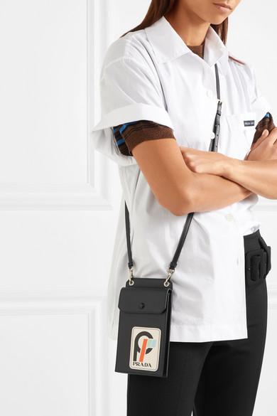 880de70981a2 Prada | Appliquéd textured-leather pouch | NET-A-PORTER.COM