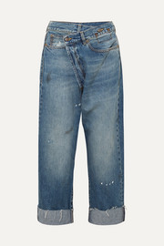 Crossover asymmetric distressed high-rise wide-leg jeans