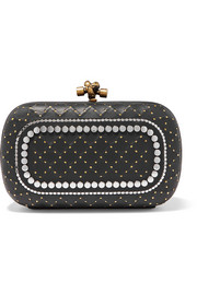 Knot embellished leather clutch