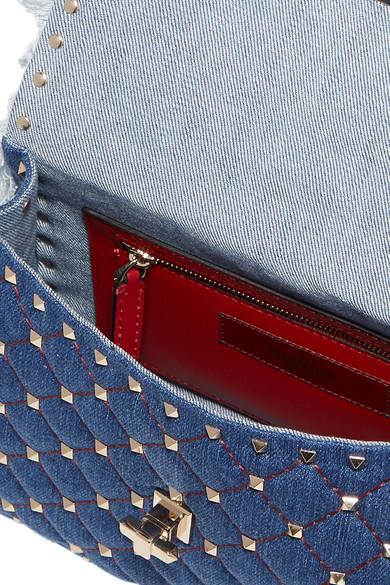 a9969d83a5b Valentino Garavani The Rockstud Spike medium quilted denim shoulder bag.  $2,675. Play