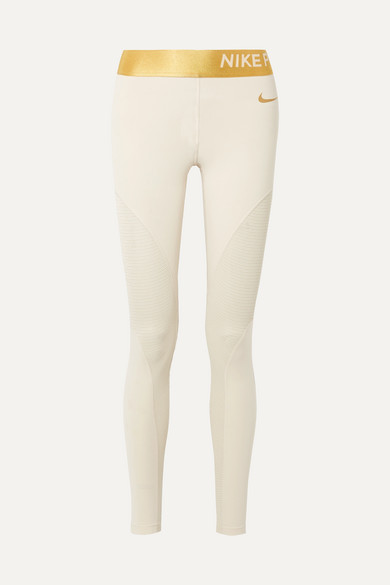 eee5146c7be46 Nike | Pro Warm metallic striped Dri-FIT paneled stretch leggings |  NET-A-PORTER.COM