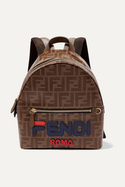 Leather-trimmed printed coated-canvas backpack