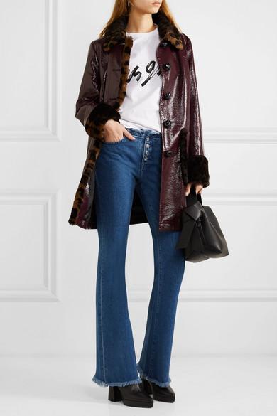 McQ Alexander McQueen. Manteau en coton enduit à finitions en fourrure  synthétique imprimée léopard 8271fc3839b