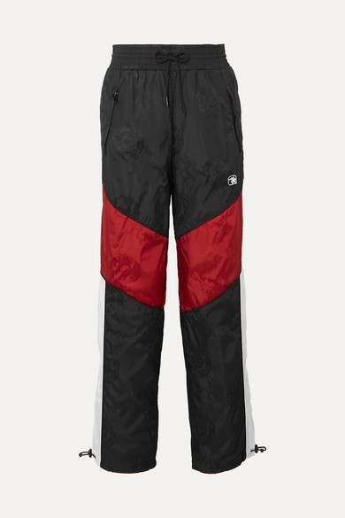 Paneled Embroidered Shell-Jacquard Track Pants in Black
