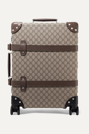 + Globe-Trotter leather-trimmed printed coated-canvas suitcase
