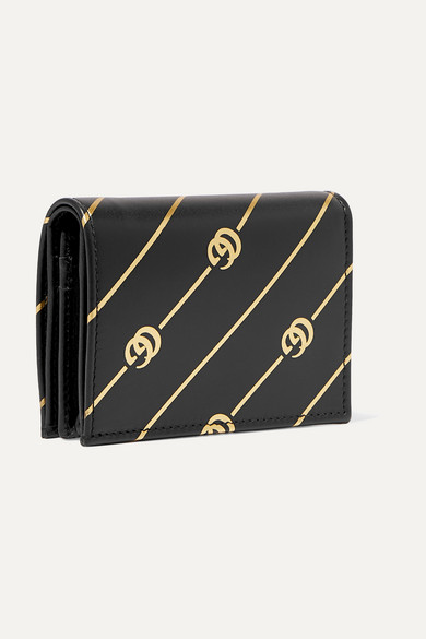 d476c809eec Gucci. Printed leather cardholder