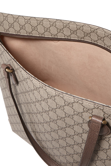 12605e89a88d Gucci. Ophidia East West leather-trimmed printed coated-canvas tote. £795.  Zoom In