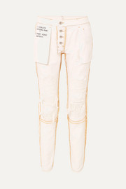 Reversible distressed mid-rise skinny jeans