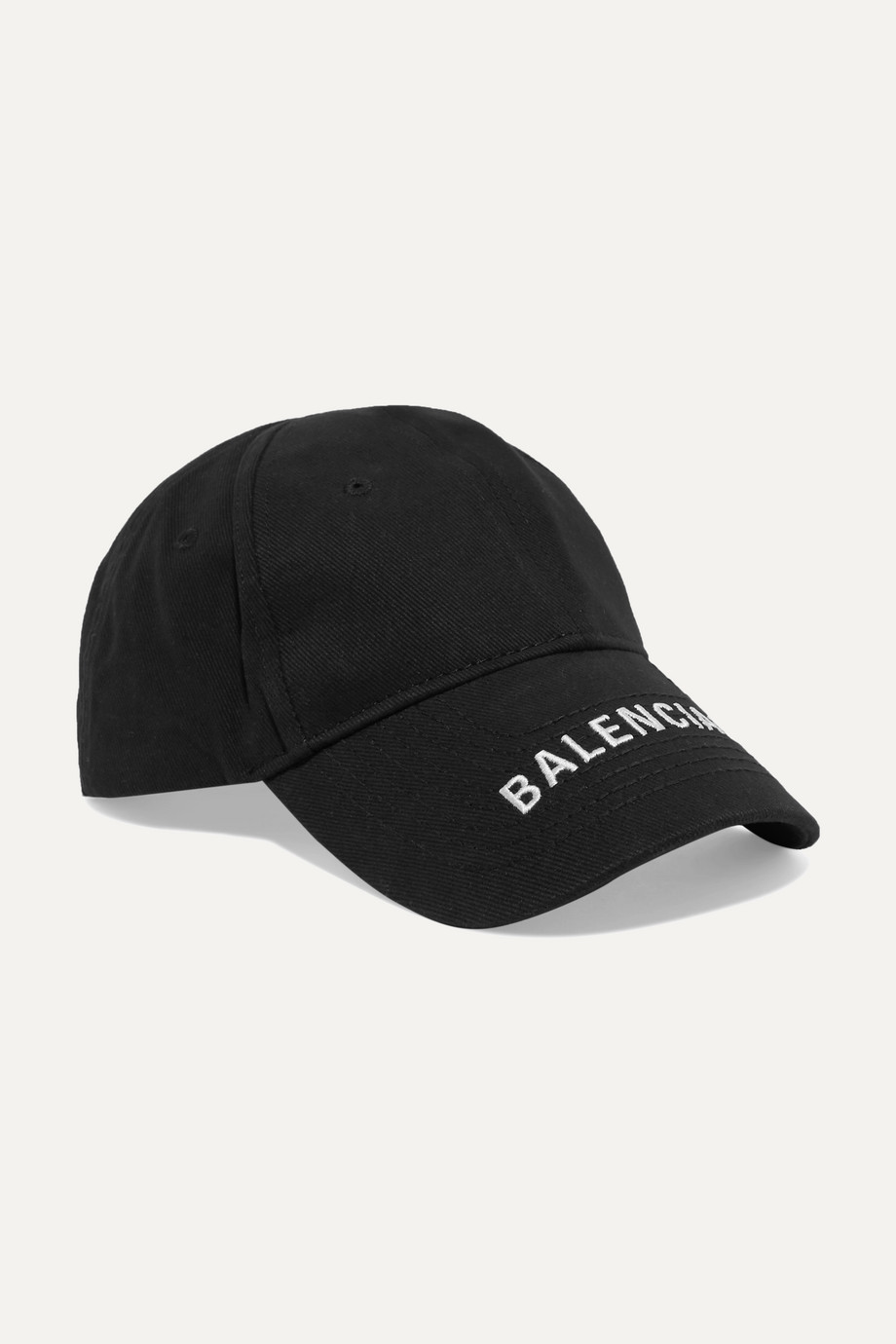 Exact Product: Embroidered cotton-twill baseball cap, Brand: Balenciaga, Available on: net-a-porter.com, Price: $450