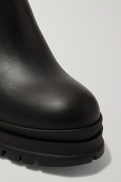bd8d19f18a69 Prada. 55 leather ankle boots.  1