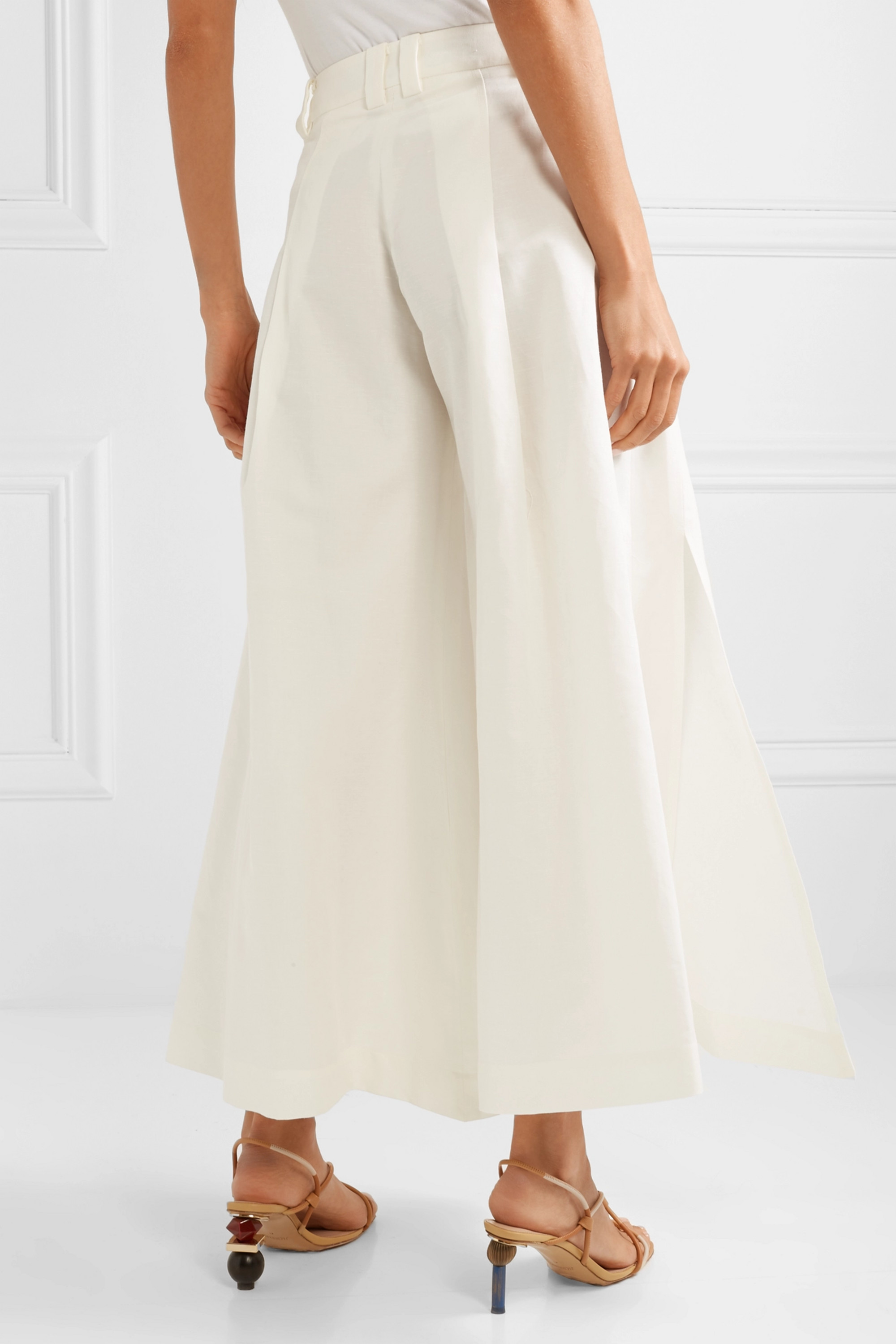 Cult Gaia Maia pleated cotton and linen-blend flared pants