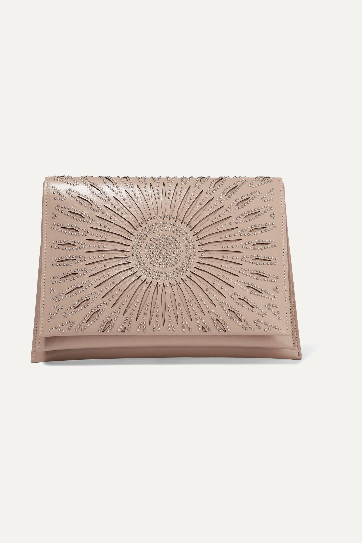 Alaïa Studded laser-cut leather clutch