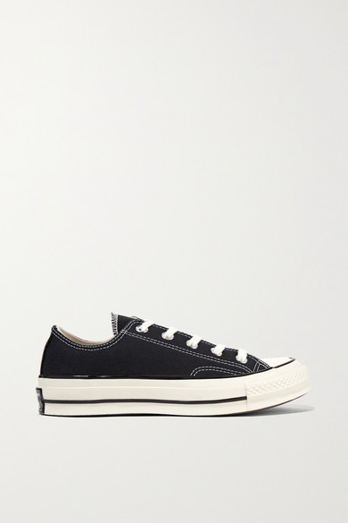 Black canvas Converse Chuck Taylor sneakers with rubber
