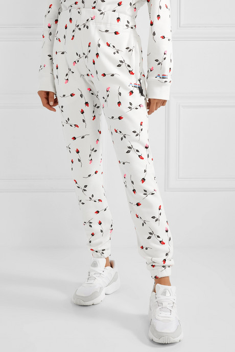 Floral-print cotton-blend fleece track pants