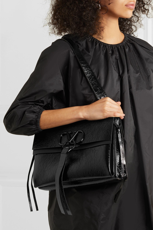 Black Valentino Garavani VRING medium glossed textured-leather shoulder bag   Valentino   NET-A-PORTER