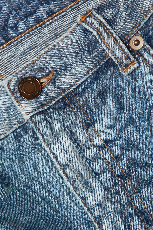 SAINT LAURENT Distressed denim mini skirt