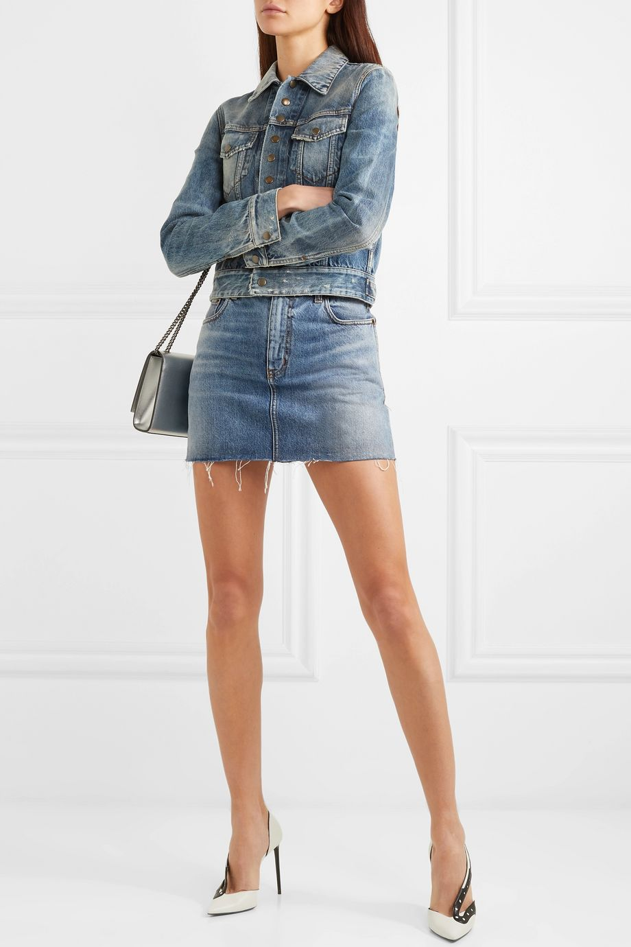 SAINT LAURENT Distressed denim mini skirt