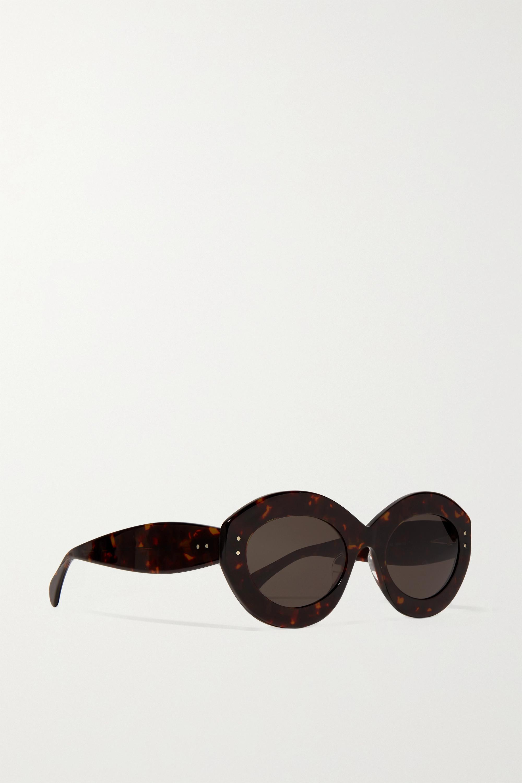 Alaïa Sonnenbrille mit rundem Rahmen aus Azetat in Hornoptik