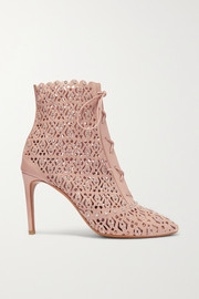 90 stud-embellished and laser-cut leather ankle boots
