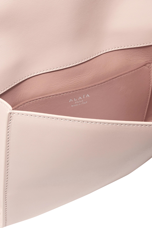 Alaïa Studded leather clutch