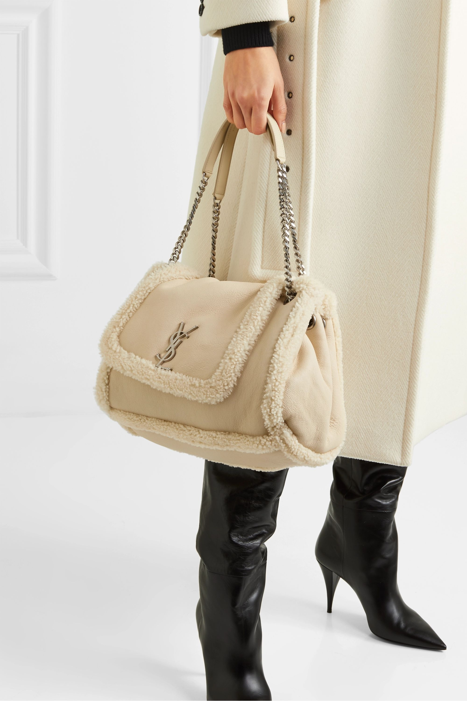 SAINT LAURENT Nolita medium textured-leather and shearling shoulder bag