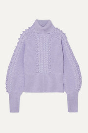 Chrissie cable-knit merino wool turtleneck sweater