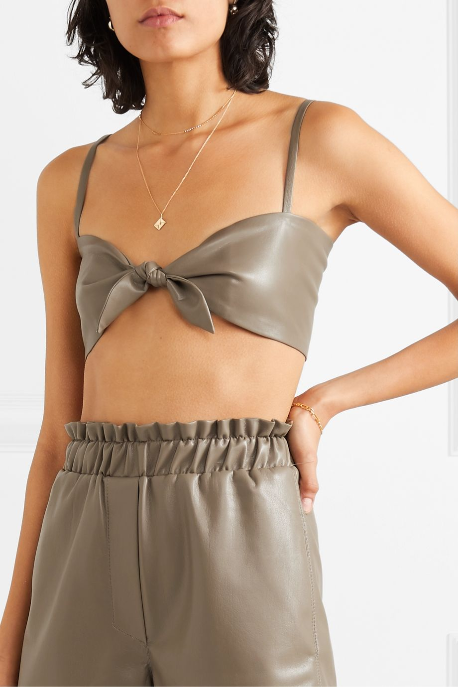 Nanushka Sili cropped knotted vegan leather top