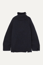 Oversized distressed mélange wool turtleneck sweater