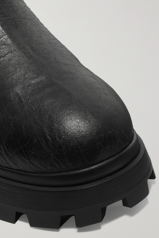 Miu Miu Stiefel aus Craquelé-Leder mit Shearling-Futter