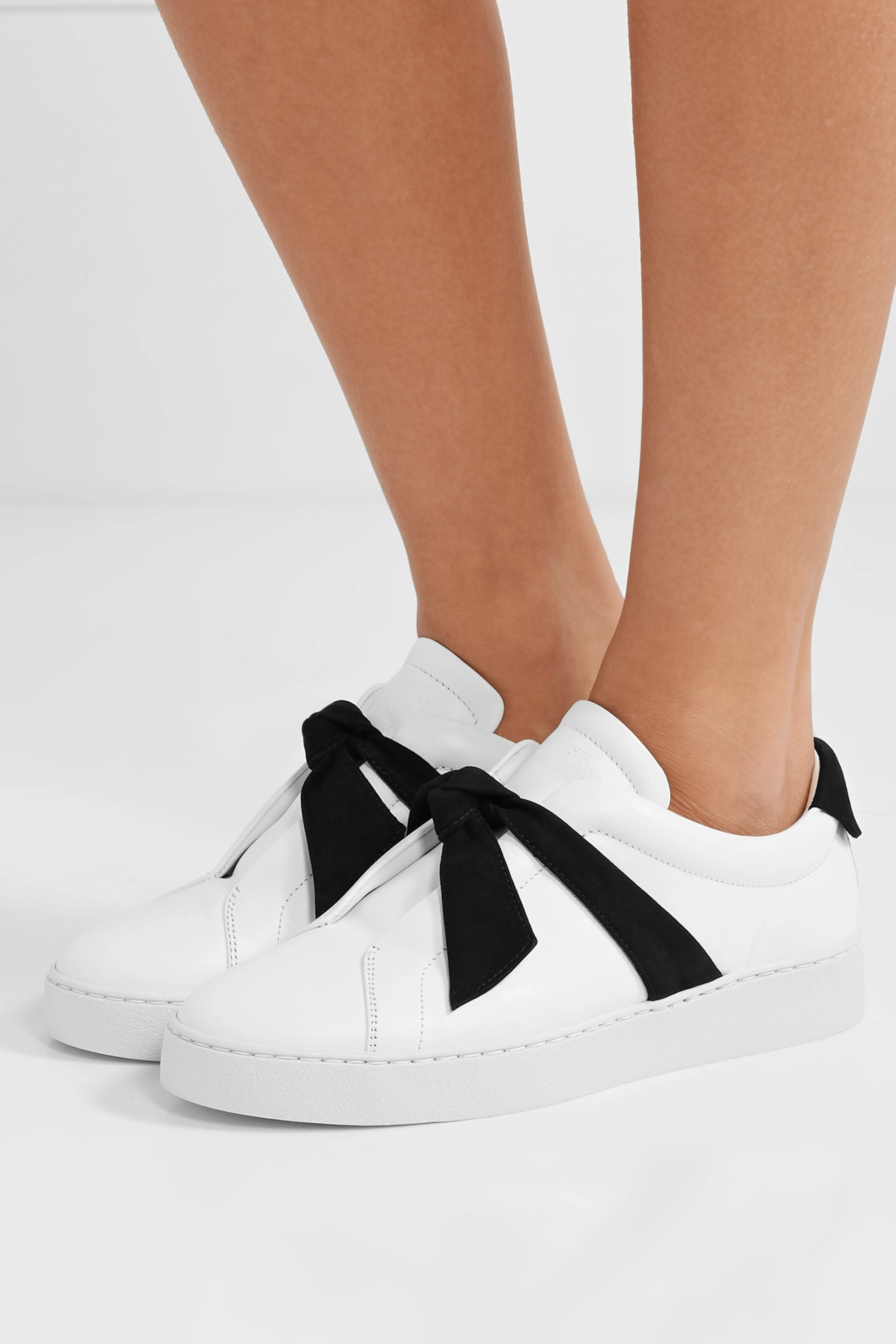 Alexandre Birman Clarita bow-embellished suede-trimmed leather slip-on sneakers