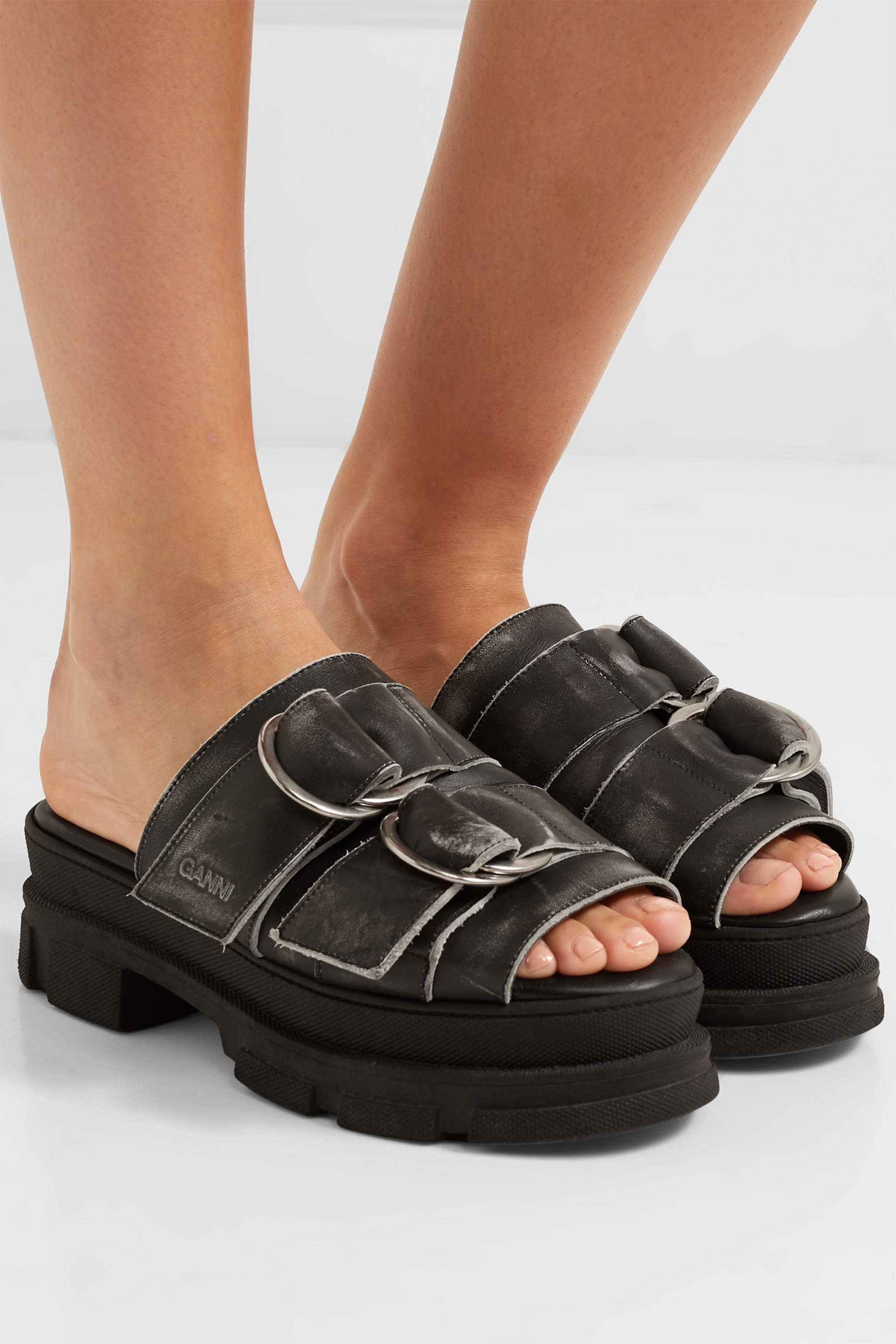 GANNI Sporty logo-embossed distressed buckled leather sandals